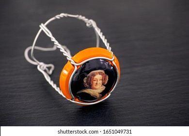 Tambov, Russian Federation - February 14, 2020 Veuve Clicquot Champagne muselet with cap on black background. Studio shot.