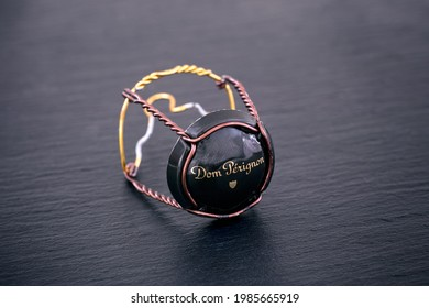 Tambov, Russian Federation - February 14, 2020 Dom Perignon Champagne muselet with cap on black background.