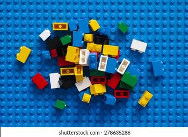 Tambov, Russian Federation - February 20, 2015 LEGO Blocks on blue baseplate. Studio shot.
