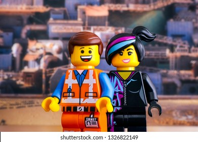 Tambov, Russian Federation - February 24, 2019 Lego Hard Hat Emmet and Lucy minifigures against Apocalypseburg background. The Lego Movie 2.