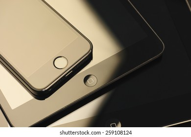 Tambov, Russian Federation - February 26, 2015 Close up of stack of Apple devices -  iPhone 5s, iPad mini and iPad 2. Studio shot.