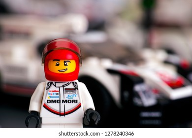 Tambov, Russian Federation - January 02, 2019 Lego Porsche 919 Hybrid driver minifigure by LEGO Speed Champions and his car on background. Studio shot.