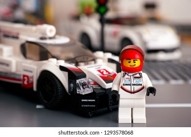 Tambov, Russian Federation - January 02, 2019 Lego Speed Champions Porsche 919 Hybrid car with driver minifigure on the road. Studio shot.