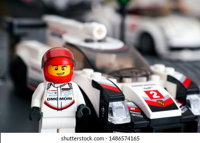 Tambov, Russian Federation - January 02, 2019 Lego Porsche 919 Hybrid driver minifigure by Lego Speed Champions against his car.