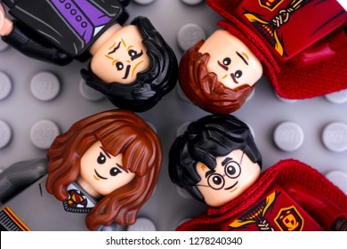 Tambov, Russian Federation - January 06, 2019 Four Lego Harry Potter minifigures - Harry Potter, Hermione Granger, Severus Snape and Oliver Wood on gray background. Studio shot.