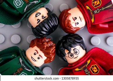Tambov, Russian Federation - January 06, 2019 Four Lego Harry Potter minifigures from Gryffindor and Slytherin teams - Harry Potter, Oliver Wood, Lucian Bole and Marcus Flint on gray background.