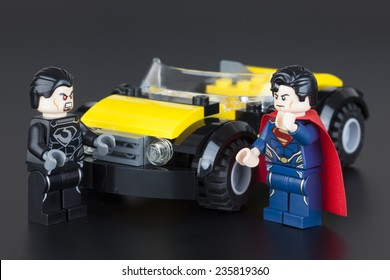 Tambov, Russian Federation - January 11, 2014 Lego minifigures of Superman and General Zod near yellow car on black background. Studio shot.