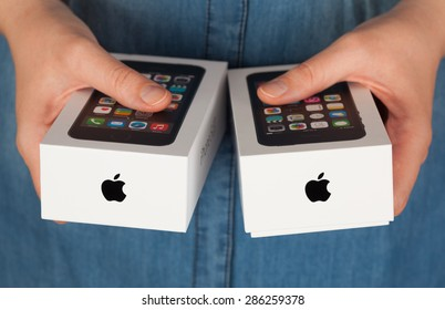 Tambov, Russian Federation - January 12, 2015 Two Apple iPhone boxes in womans hands.  Studio shot.