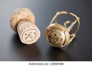Tambov, Russian Federation - January 14, 2014 Moet & Chandon Champagne cork and muselet with cap on black background. Studio shot.