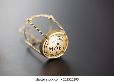 Tambov, Russian Federation - January 14, 2014 Moet & Chandon Champagne muselet with cap on black background. Studio shot.