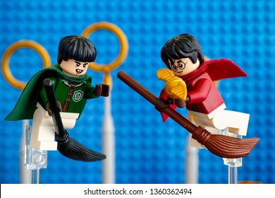Tambov, Russian Federation - January 20, 2019 Quidditch Match Lego Harry Potter play set. Marcus Flint and Harry Potter on broom captured the Golden Snitch against blue baseplate background.