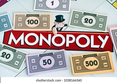 Tambov, Russian Federation - January 26, 2018 Center of Monopoly gameboard with money packs. Studio shot.
