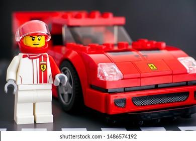 Tambov, Russian Federation - July 02, 2019 Lego Ferrari F40 Competizione driver minifigure by LEGO Speed Champions near his car. Studio shot.