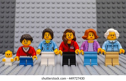 Tambov, Russian Federation - July 06, 2016 Six Lego woman minifigures of different age - from baby to old lady - with gray baseplates background. Studio shot.