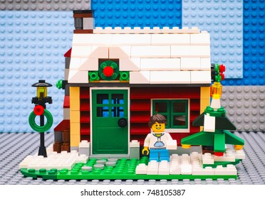 Tambov, Russian Federation - July 06, 2016 Lego girl with snowball near Christmas tree opposite her house. Studio shot.