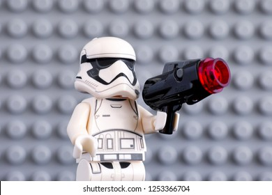 Tambov, Russian Federation - July 08, 2018 Lego First Order Stormtrooper minifigure with blaster against gray baseplate background. Studio shot.