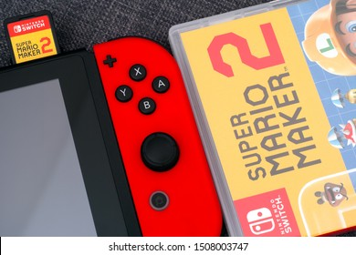 Tambov, Russian Federation - July 09, 2019  Super Mario Maker 2 video game box and Nintendo Switch video game console with cartridge in it.