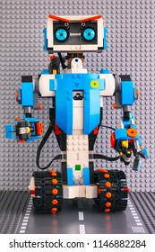 Tambov, Russian Federation - July 27, 2018 Lego BOOST robot standing on the road baseplate against gray baseplate background. Studio shot.