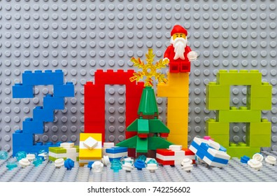 Tambov, Russian Federation - June 15, 2017  Lego New year 2018 concept. Numbers 2018, christmas tree, presents  and Santa Clause sitting on number One. Custom scene. Studio shot.