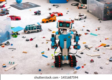 Tambov, Russian Federation - June 16, 2019 Lego BOOST robot standing on room floor with other Lego toys, bricks and baseplates.