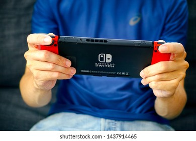 Tambov, Russian Federation - June 22, 2019 Man playing Nintendo Switch video game console.