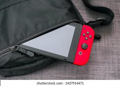 Tambov, Russian Federation - June 22, 2019 Nintendo Switch video game console in black bag.