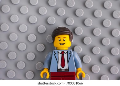 Tambov, Russian Federation - June 22, 2017 Lego businessman on gray baseplate background. Studio shot.
