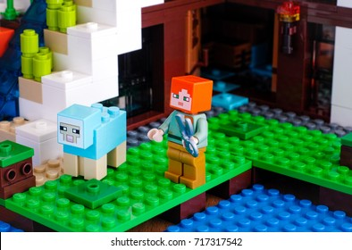 Tambov, Russian Federation - June 25, 2017 Lego Minecraft. Alex with sheep shears catching to shear the dyed sheep on Waterfall Base. Studio shot.