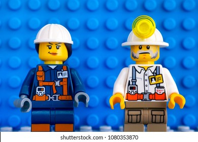 Tambov, Russian Federation - March 09, 2018 Two Lego miners against blue baseplate background. Close-up.