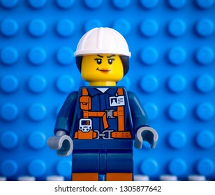 Tambov, Russian Federation - March 09, 2018 Lego woman worker minifigure against blue baseplate backgrounds.