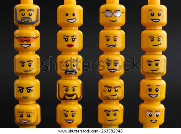 Tambov, Russian Federation - March 24, 2015 Lego figure heads on black background. Studio shot.