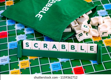 Tambov, Russian Federation - May 02, 2018 Scrabble Board Game. Word Scrabble from letter tiles in the tile rack on  gameboard with drawstring letter bag. Studio shot.