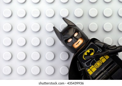Tambov, Russian Federation - May 12, 2016 Lego Batman minifigure on Lego gray baseplate background. Studio shot.