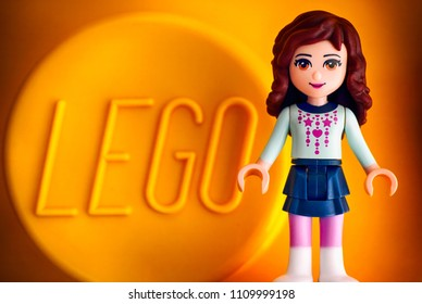 Tambov, Russian Federation - May 20, 2018 Lego Friends girl minifigure against yellow background with word LEGO. Studio shot.