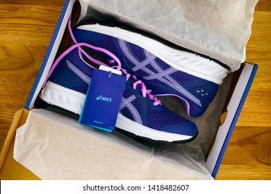Tambov, Russian Federation - May 24, 2019 New blue Asics running shoes in box.