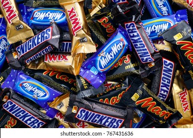 Tambov, Russian Federation - November 15, 2017 Snickers, Mars, Milky Way and Twix minis candy bars. Full Frame. Studio shot.