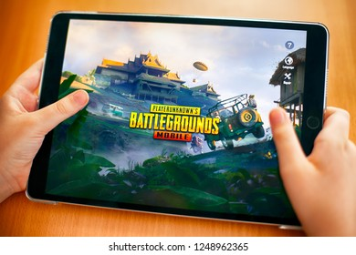 Tambov, Russian Federation - November 23, 2018 Teenager going to play PlayerUnknown's Battlegrounds (PUBG) Mobile mobile game on iPad.