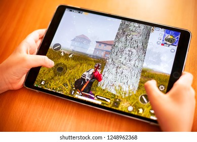 Tambov, Russian Federation - November 23, 2018 Teenager playing PlayerUnknown's Battlegrounds (PUBG) Mobile mobile game on iPad.