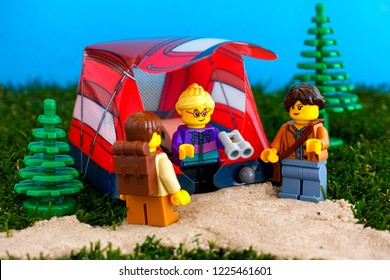 Tambov, Russian Federation - October 31, 2018 Three Lego tourist minifigures near their tent outdoors. Close-up.