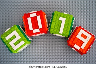 Tambov, Russian Federation - September 02, 2018 Lego New year 2019 concept with Lego cubes on gray baseplate background.