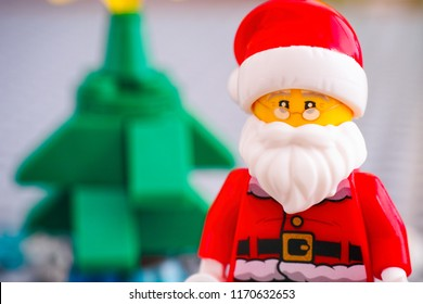 Tambov, Russian Federation - September 02, 2018 Portrait of Lego Santa Claus against Christmas tree. Studio shot.