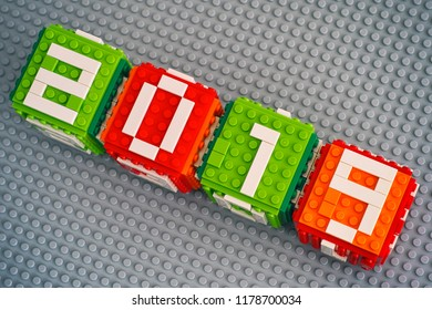 Tambov, Russian Federation - September 02, 2018 New year 2019 concept. Lego cubes with numbers 2019 on gray baseplate background.