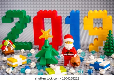 Tambov, Russian Federation - September 02, 2018 Numbers 2019 made by Lego blocks, christmas tree, Santa Clause with bag, presents and Lego round blocks on Lego gray baseplates. New Year concept.