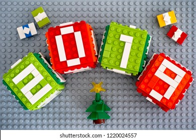 Tambov, Russian Federation - September 02, 2018 Lego New year 2019 concept with Lego cubes, gifts and Christmas tree on gray baseplate background.