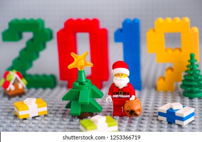 Tambov, Russian Federation - September 02, 2018 Christmas tree, Santa Clause with bag and presents against  numbers 2019 made by Lego blocks on gray baseplates. New Year concept. Studio shot.