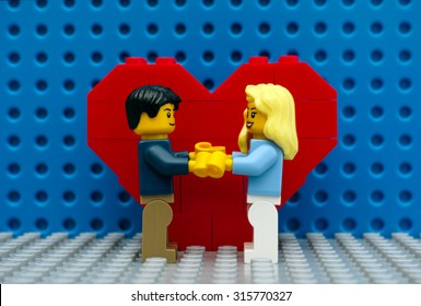 Tambov, Russian Federation - September 03, 2015 Lego couple standing in front of the heart on Lego baseplates. Studio shot.