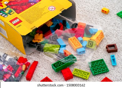 Tambov, Russian Federation - September 07, 2019 Lego blocks and bricks spill out of LEGO box. Close-up.