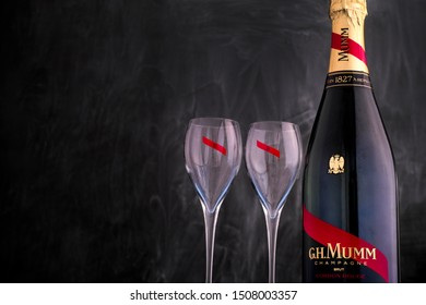 Tambov, Russian Federation - September 07, 2019 Bottle of Champagne G.H. Mumm with two wine glasses against black background. Studio shot.