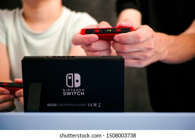 Tambov, Russian Federation - September 07, 2019 Man and boy playing Nintendo Switch video game console.
