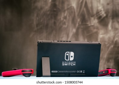 Tambov, Russian Federation - September 07, 2019 Nintendo Switch video game console on the table against black background.
